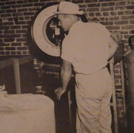 Lester H. Edwards, Sr. is a Warehouse employee, weighing a shipment of materials - 1948