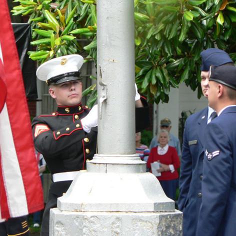Cpl. Tyler Goulding, a veteran, U.S. Marine Corps, raises the American Flag 2014