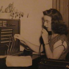Elizabeth Johnson, receptionist works the mill's telephone service - 1946