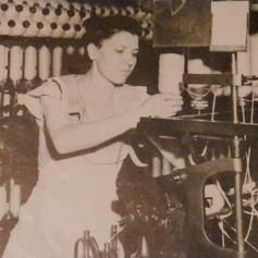 Estelle Williams Minshew creels a speeder in the Card Room - 1946