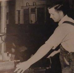 Arnold Freeman, returning veteran, works in the shop. He is son of H.L. Freeman, master mechanic - 1946