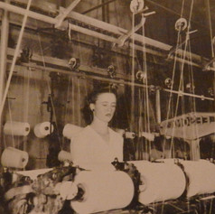 Dollie Heaton works 2nd shift in the Winding Room at a doubler machine. 1945