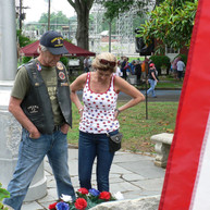 Mike and Anna Hester, of Rockmart, pause at the Brighton Mills World War II monument 2014