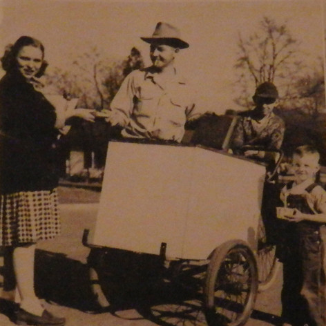 The ice cream cart in the Village is always popular. Young lady is Barbara Pence. 1948