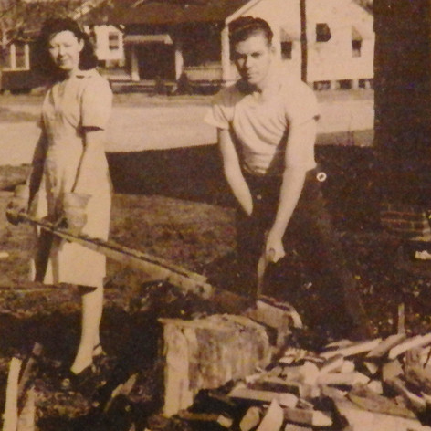 Wiley Henson & his wife cut wood for their home in the Village - 1948