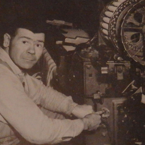 Electrician Elmer Swinford is attaching a motor and wiring a new loom - 1949