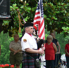 Joe Dunaway plays Amazing Grace on the bagpipes during closing of Memorial Ceremony 2014
