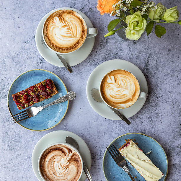 An image of a cup of coffee and a flapjack cake served by Coast Coffee in Christchurch