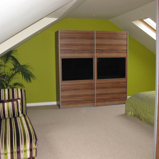 Attic Bedroom with coombed ceilings