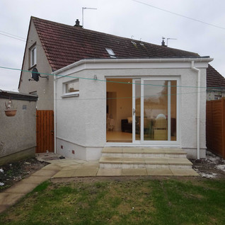 Open plan living space with garden access