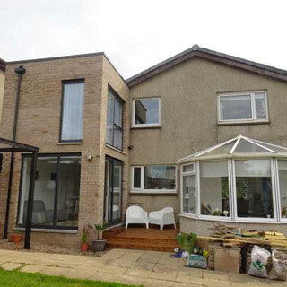 Full height glazing to a contempory addition