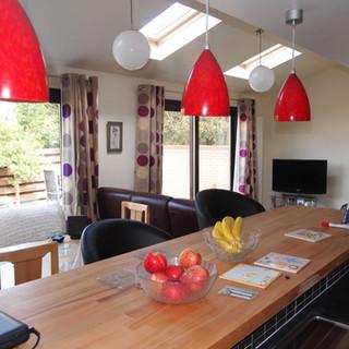 Open plan kitchen dining sitting area