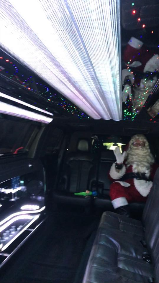 Santa Clause riding in our Lincoln
