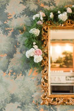 floral adorned mirror