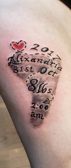 baby foot print tattoo idea