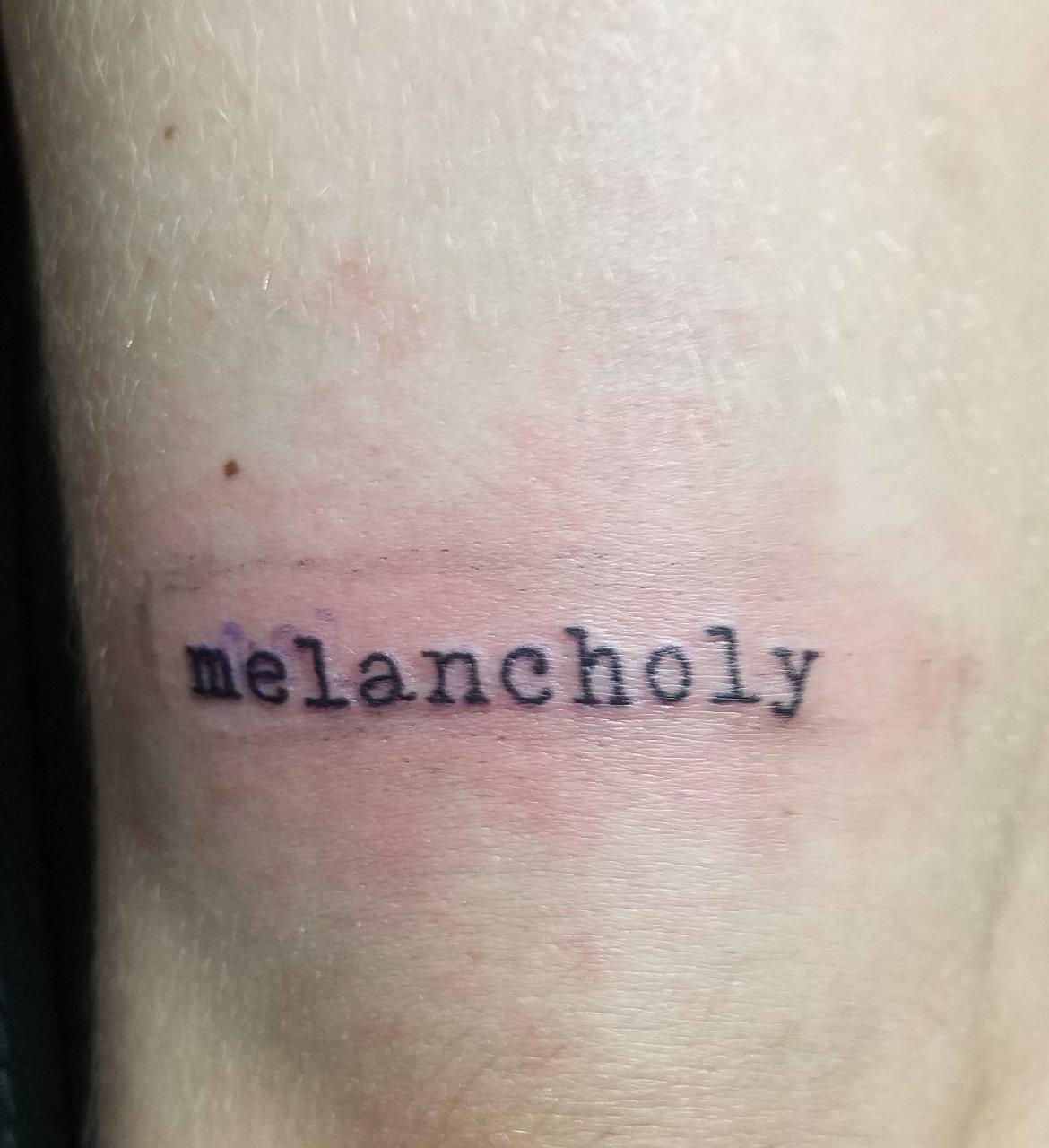 tattoo that says melancholy