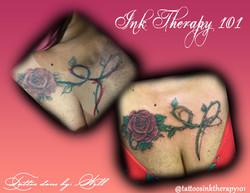 Rose across chest tattoo