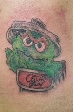 sesame street oscar tattoo