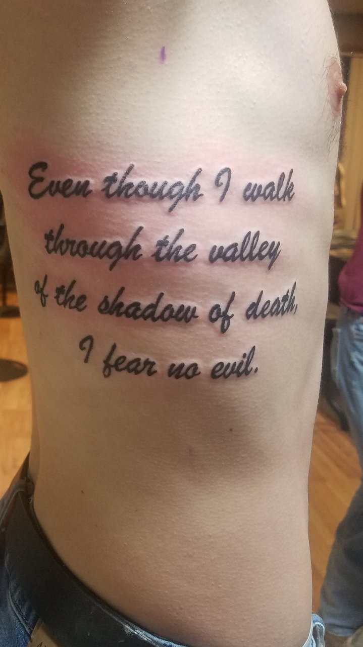 bible verse tattoo on rib cage