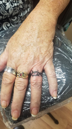 crown of thorns finger tattoo