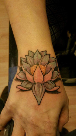 lotus hand tattoo