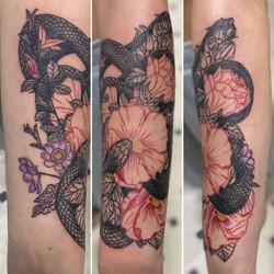 Snake weaving between flowers