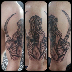 black and grey horror tattoo