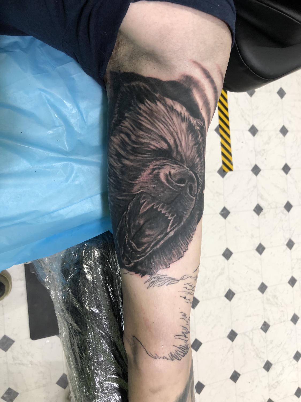 wilderness tattoo sleeve bear
