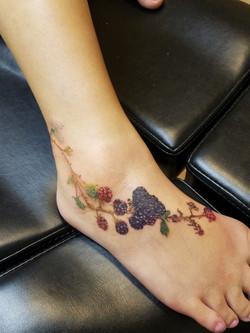 realistic black berries tattoo