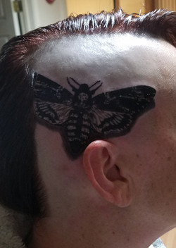 death moth side of head tattoo