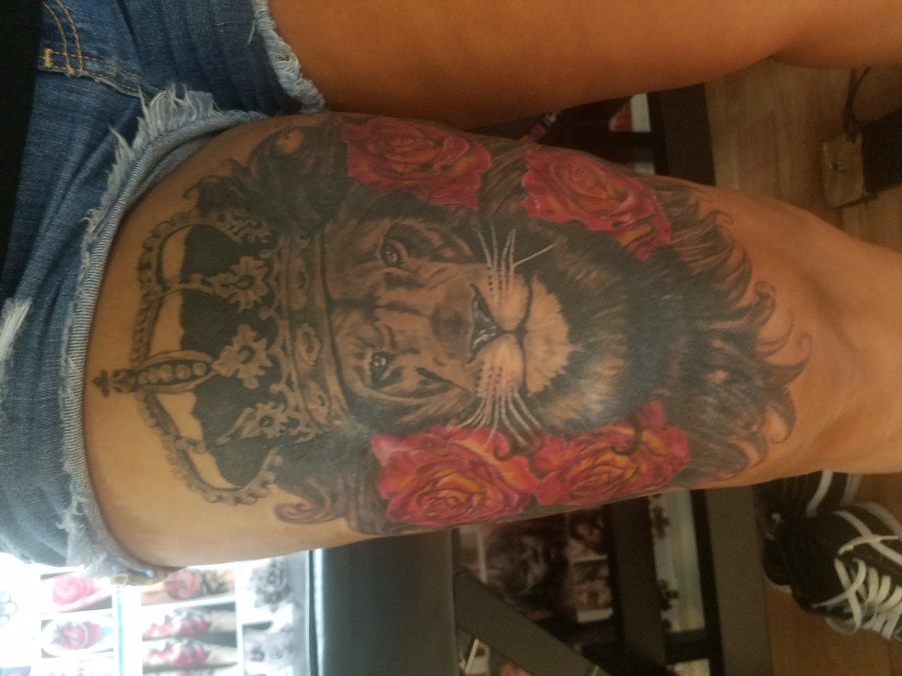 lion with roses and crown tattoo