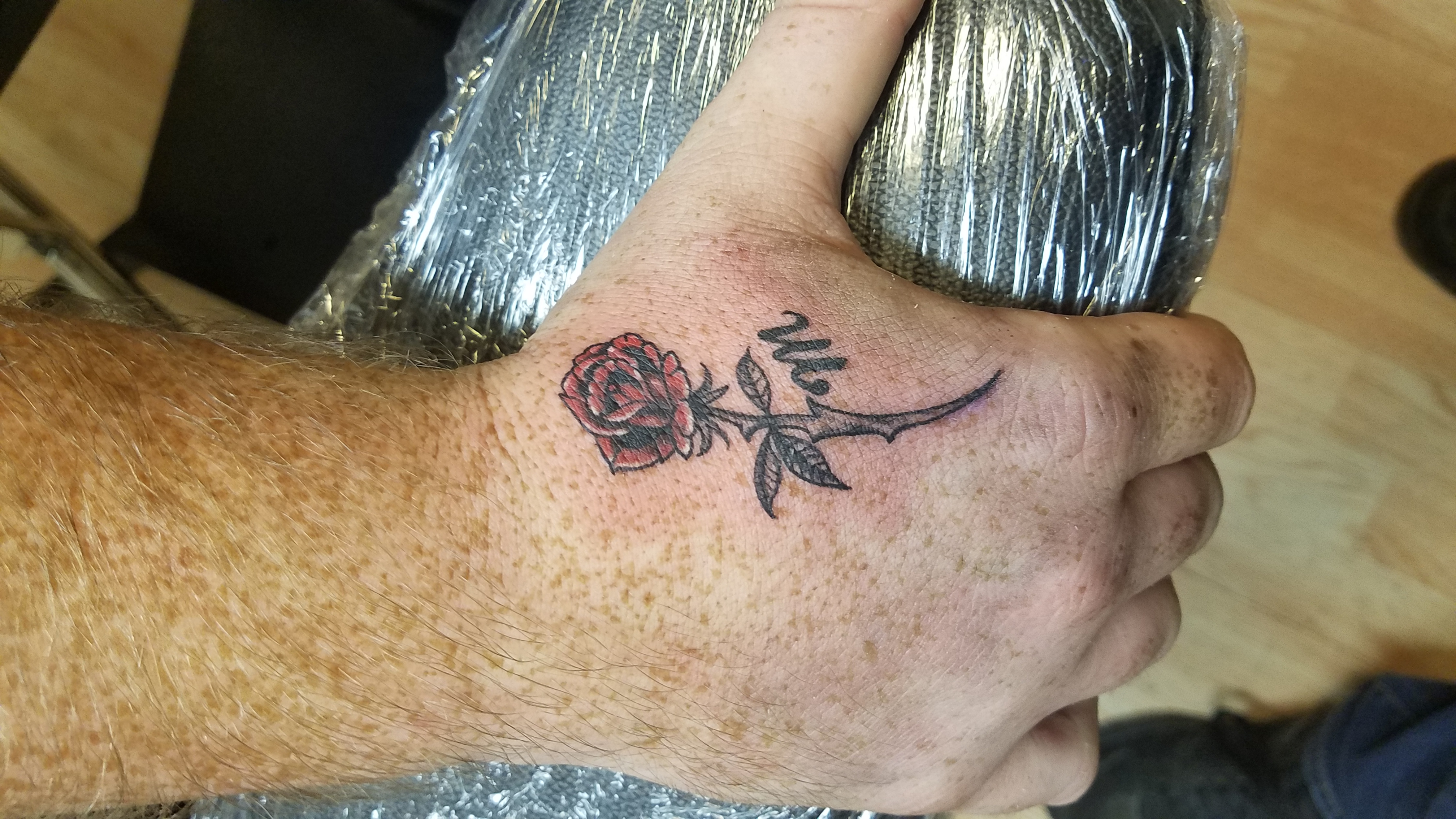 pretty rose hand tattoo