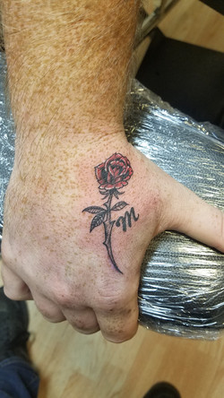 pretty rose hand tattoo