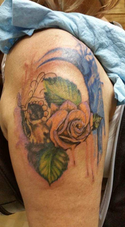 skull with rose watercolor tattoo