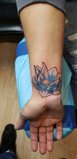 tattoo cover up with a flower