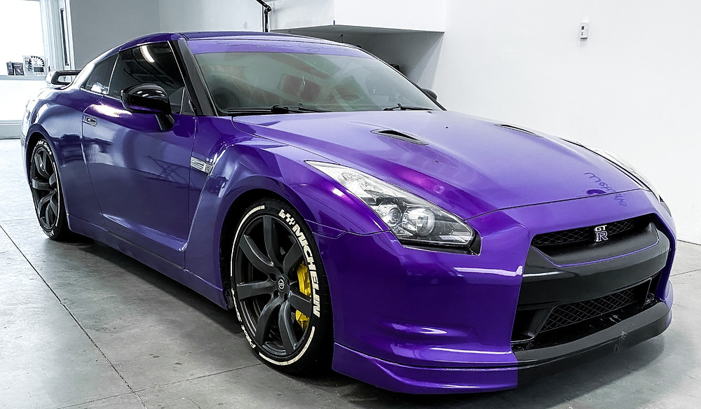 Customized Shiny Purple Vinyl Wrap on a Nissan GT-R Sports Car by Wetwerks Auto Spa