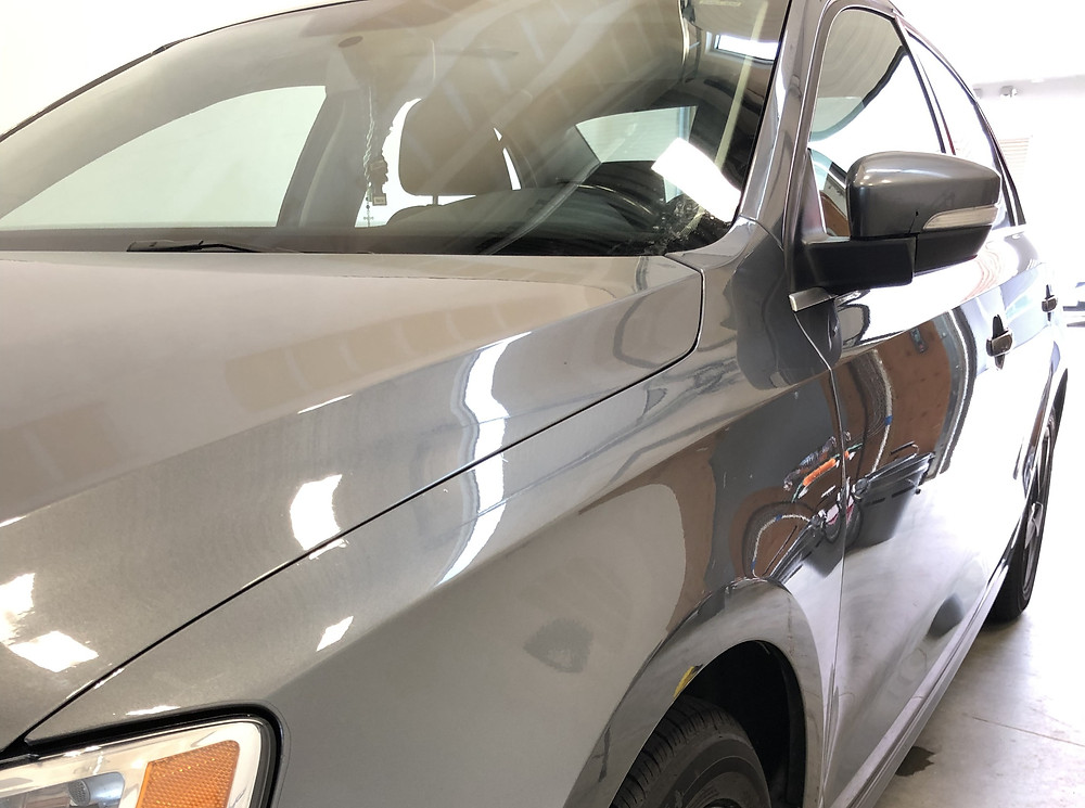paint protection film, with intense shine on grey vehicle.