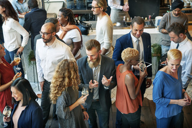 Business professionals mingling