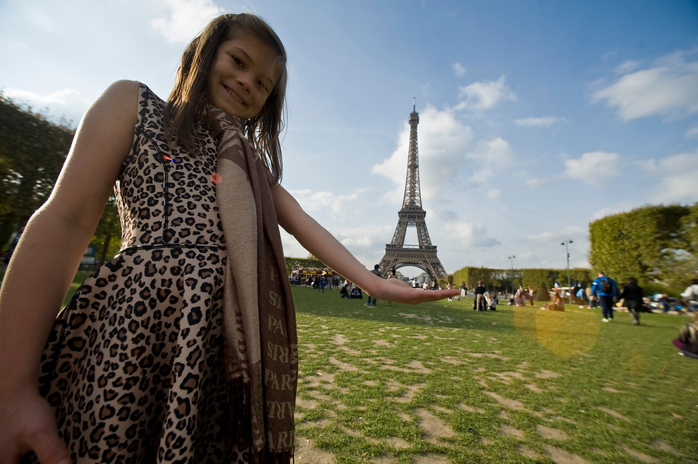 This is me holding the Eiffel Tower in Paris, France.