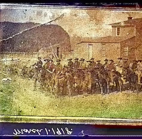 Men in Corrine defending against Shoshone Indian attack - c1875