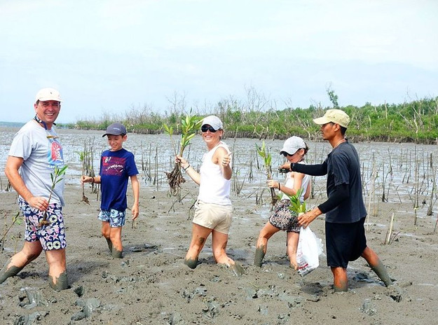 International tourists visiting rice paddies in the countryside
