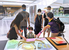 Young family with kids on speaking tour at Changi Airport