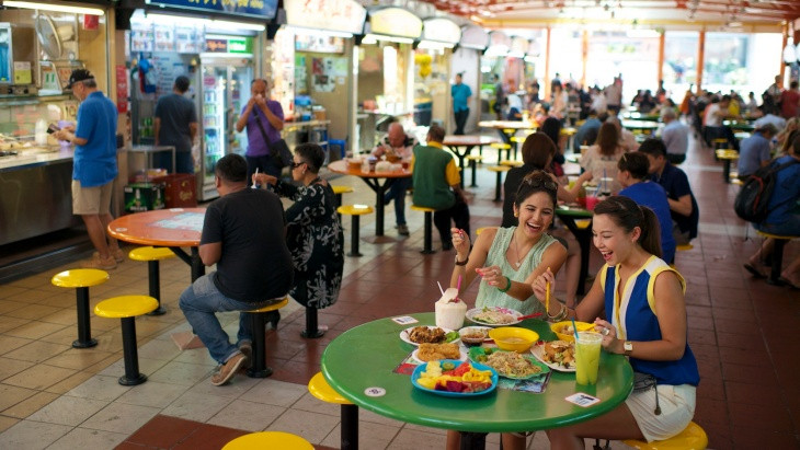 Enjoy delicious local food at a hawker centre in Singapore