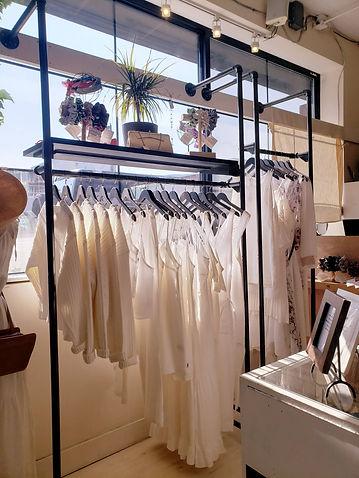 white clothing hanging in sunny stroe window kelowna bc stone fox