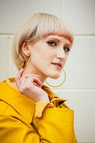 Gold-hoop-earrings-vintage-yellow-leather-coat