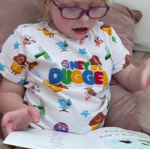 Poppy reading for her fundraiser