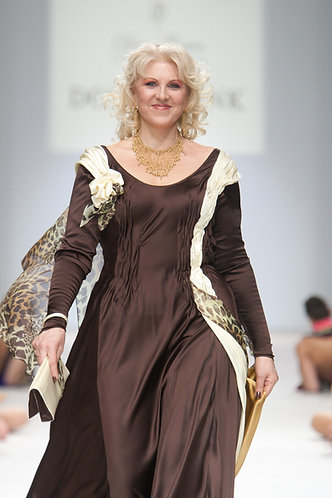 Dress with draperies of complex silhouette