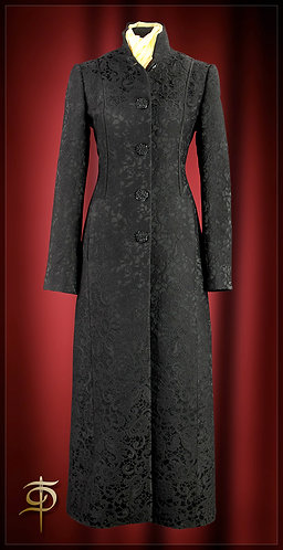 Black coat made of jacquard with satin finish. DressTheatre Couture