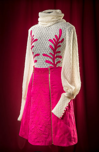 Suit: knit wool blouse with applique and quilted fuchsia skirt.