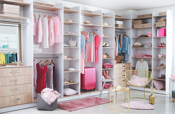 Large wardrobe with modern clothes and a
